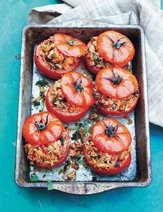 Greek rice-stuffed tomatoes - a gorgeous summer side, makes a lovely vegan main dish too!