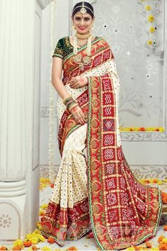 Bridal Wear Banarasi Silk Red And Off White Traditional Saree For more information :- Call us @+919377222211 (Whatsapp Available)
