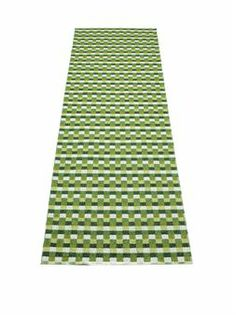 Mose is a stylish checked rug in green colors from the Swedish compay Pappelina. Available in several sizes.