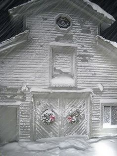 Snow-covered barn.