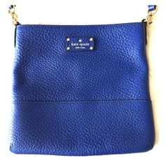 "Kate Spade small crossbody purse Cobalt blue leather purse. Inside lining is white with black and gold polka dots and spades. Inside also has a zipper pocket and 2 pockets. Great condition, only used a handful of times. Purse is 10"" tall and 10.5"" wide. kate spade Bags Crossbody Bags"