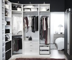 Kind of loving the idea of IKEA PAX wardobes in my bedroom, running from the column next to the door, around the corner, to halfway to the fireplace...achievable? Hmmm. Not open like this pic, though - the black/brown Hemnes ones.