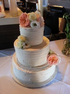 A buttercream ripple cake with fresh flowers is perfect for any wedding celebration!