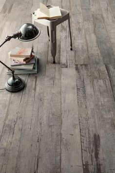 This incredible distressed wood floor has a secret. It's not really wood. It's wood looking tile. Introducing Blendart - the new porcelain tile collection by Ceramica Sant'Agostino. The gnarled wood effect is magnificent. Wood Tile Floors, Wood Look Tile, Wooden Flooring, Kitchen Flooring, Timber Tiles, Penny Flooring, Cork Flooring, Brick Flooring, Basement Flooring