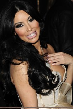 """kimmmieeee! kim! kimster!  i love her, she hasn't had plstc sgry HER BODY PARTS ALL REEL its a gr8 show & she's naturally gorgeous so JUST DEAL WITH IT H8TERS. but does she qualify as Role Model of the year?  if you get a sex tape leaked, you should be crawling under your bed FO LIFE & preferably, sanely NOT be attention whoring yourself out there with a friggin reality show & """"family empire"""" .  anway Kim Kardashian...candidate for Role Model of the Year!"""