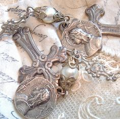 """This gives me an idea....make a """"charm"""" bracelet with old religious medals."""