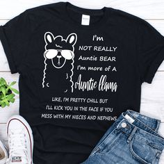 I'm not an auntie bear I'm more of an auntie llama t shirt - Gebli I'm not an auntie bear I'm more of an auntie llama like I'm pretty chill but I'll kick you in the face if you mess with my niece shirt Preston, Aunt And Niece Shirts, Best Auntie Ever, New Aunt, Llama Shirt, Aunt Gifts, Unisex, Graphic Shirts, Tee Design