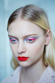 At the Christian Dior haute couture show earlier this month [July 2012], Raf Simons's debut collection was punctuated with futuristic makeup notable for the fluorescent eyeliners that echoed each design