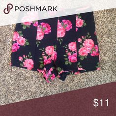 High waisted shorts These shorts have a flower design on it and are high waisted. NWOT Nollie Shorts
