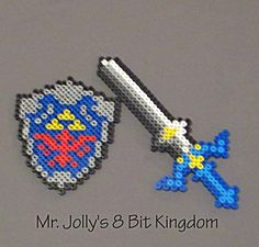 This Legend of Zelda Sword and Shield set is handcrafted out of Perler beads and will make excellent decorations for the wall, fridge or anything you can think of! These sprites are inspired by the characters in the Legend of Zelda. Mr. Jolly's 8 Bit Kingdom does not claim the copyright to th...