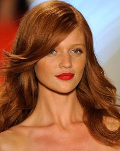 most striking red hair color I've ever seen. she is gorgeous.