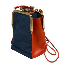 never used bonnie cashin leather & denim shoulderbag presented by funkyfinders | From a collection of rare vintage handbags and purses at https://www.1stdibs.com/fashion/accessories/handbags-purses/
