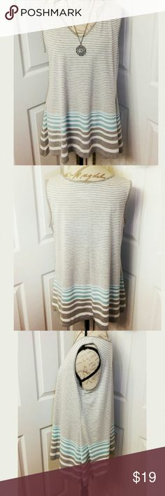 "Avenue Sharkbite Tank Size 14-16 NEW! Gray & turquoise stripes on a off-white background. Runs a little big for 14-16 so definitely on the 16 end of size, to possibly size 18. Chest measures 22"" pit to pit & length 28.5"" from center front shoulder seam. Hemline has a 37"" sweep from side seam to seam. New With Tag! Avenue Tops Tank Tops"