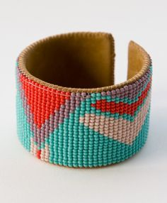 Our Chasing Triangles Cuff is hand-beaded and stitched onto beautiful leather in Guatemala.
