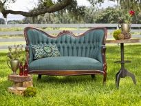 whimsical woodland setting with teal settee