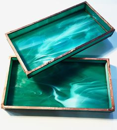 Opaque marbled green glass is reminiscent of green malachite and is crafted using traditional soldering techniques.