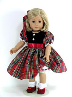 Includes: 18 inch Christmas Holiday Doll Dress, Pantalettes, Hair Ribbons with Shoes and Socks Option  Fits 18 inch American Girl, Madame Alexander and similar sized dolls  Dress Features: - black velveteen and red, green blue and gold metallic plaid taffeta  - LINED velveteen bodice with