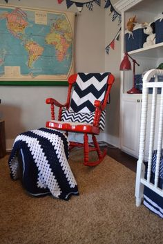 Adorable red rocking chair in a super cute nursery!