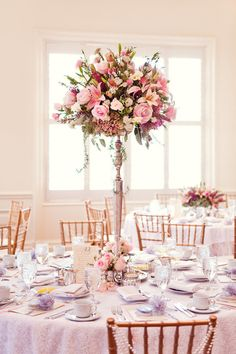 Unruly floral centrepieces were the perfect punctuations for tea-party-like tables at a @Mandy Bryant Bryant Bryant Dewey Seasons Hotel Las Vegas wedding.