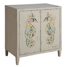 Weathered wood cabinet with hand-painted seahorse motif. Product: Accent chestConstruction Material: WoodColor: Off-white, green and blueFeatures: One removable shelf behind two push latch doorsHand-paintedStraight legs   Dimensions: 30 H x 28 W x 16 D