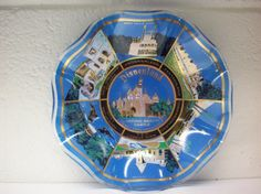 This glass candy dish/ ashtray is a souvenir from Disneyland in California. It would be great for serving snacks at your next retro themed party. It measures 7 1/2 in diameter and features Disneylands popular attractions of the time: Sleepy Beautys Castle, Adventure Land, New Orleans Square, Main Street USA, Tomorrowland, Fantasyland and Frontierland. From my research, I think this piece dates from the 70s.  It is in wonderful condition, clean and ready to use. THE FINE PRINT:  Ship...