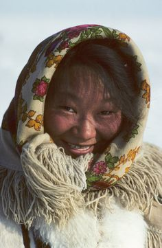 young nenets woman, wearing a headscarf   yamal   siberia   russia   foto: bryan & cherry alexander