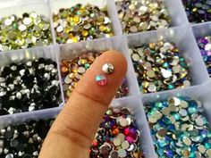 4 mm pointed end, AB coated rhinestones...