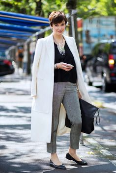 This look is convincing us to try a pixie cut! And love that coat over the shoulders look.