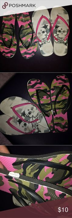 2 Pair of Flip-flops 2 pair one price.  Really cute Pool Party pink & green camo flip flops.  Brand new with tag on side, never worn.  They r too big for me.  Also a different brand of flip flops with hand-painted skulls.  Which is probably why the picture wore away some the first and only time I wore them.  But otherwise they are in EUC..also too big. I wet rubbed the camo pair and no paint came off.  My cost skull pair $23, camo $16.  Price firm. Pool Party Shoes