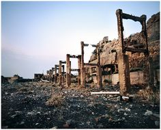 Explore 'Battleship Island,' the isolated city that's sat untouched off the coast of Japan since 1974 Hashima Island, Desert Places, Nagasaki, Battleship, Abandoned Places, Monument Valley, New York Skyline, Scenery, Coast