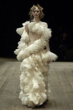 Alexander McQueen--Bulky ruffles that are scattered in unattractive bulges throughout this outfit!