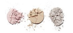 Cracked and broken make up powder compacts. Creative still life photography of cosmetics makeup. By luxury goods still life photographer, Josh Caudwell. For product and editorial photography. London, New York, Paris, Milan.