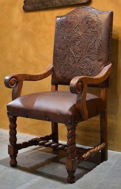 The Silla Chapital tooled leather dining chairs with arms are hand carved from solid mesquite wood, and feature genuine hand-tooled leather. Much time is put into making their beautifully carved tu…