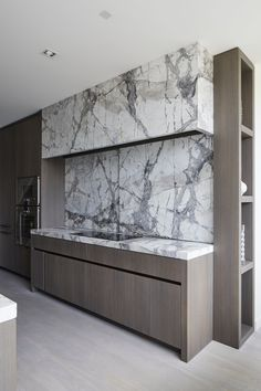 Favorite Element: The custom kitchen and closets by Obumex. Sliding Sydney Slabs of marble in the kitchen and terracotta leather lined shelving in the closet show that your limitation is really only imagination with their craftsmanship.
