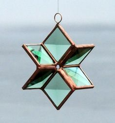 Three Dimensional Green Beveled Stained Glass Star with Copper Lines - Small. $25.00, via Etsy.