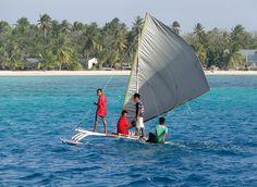 Kids sailing in Ailuk Island, RMI