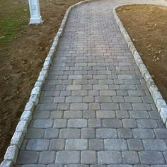 Pavestone Plaza Squares & Recs with Cobble Stone border - Yelp