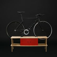 BUFF3T cabinet for bicycles, with underneath storage. It is available in white, tan, black, pine natural plywood and colors to choose from. Read to assemble, no tools required. The product includes assembly manual.