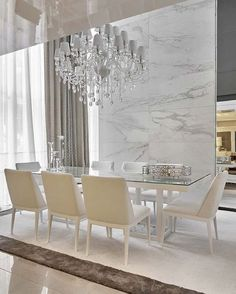 I Love using Marble on the Wall to decorate a room. It enhances the beauty of this Exquisite Chandelier!