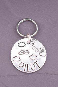 This personalized dog tag is hand stamped just for you and your pet! This original pet tag is handcrafted at The Dancing Hound's studio. Each letter and image is carefully hand stamped into the metal, one letter at a time. Dog Name Tags, Dog Id Tags, Pet Tags, Custom Dog Tags, Large Animals, Dog Names, Hand Stamped, Your Pet, Dancing