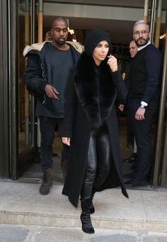 Pin for Later: See Everything Kim Kardashian Wore at Paris Fashion Week Kim Bundled Up For the Cold in a Fur-Collared Coat and Slouchy Black Beanie