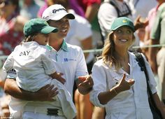 Australian golfer Jason Day with his wife Ellie and son Dash as his caddies in the Par-3 contest