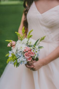 soft wildflower bouquet #bohowedding #wildflowerbouquet http://www.weddingchicks.com/2013/12/03/enchanting-boho-chic-wedding/
