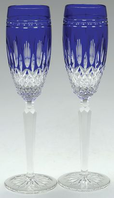 Waterford Clarendon-Cobalt 2-Piece Champagne Glass Set    With vertical, thumbprint, and crisscross cuts that show clear against the brilliant cobalt blue of the bowl, a multi-sided stem, and round foot with starburst cuts, the Waterford Clarendon-Cobalt fluted champagne glass is a glittering addition that will add a burst of color to any formal dining table or soiree on the patio.