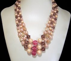 Mid Century triple strand graduated beads necklace Pale pink round faux pearl beads, lavender bicone lucite beads, and 3 dark pink art glass beads Strands are 20, 22, and 24 inches long. This can be worn up to 2 inches shorter Lovely colors for spring and summer Hook clasp is signed Japan Good condition I specialize in vintage beaded jewelry, please visit my shop to see more International buyers welcome, overcharges are refunded Flat rate priority shipping is optional 42917   Want to see…