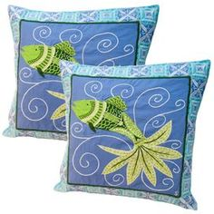 """Hand-dyed cotton pillow with an embroidered fish motif. Product: PillowConstruction Material: 100% Cotton cover and polyester fillColor: Blue and multiFeatures: Hand-dyed, hand-cut applique and embroidery  Envelope style closure with covered buttonsInserts includedDimensions: 18"""" x 18""""Cleaning and Care: Dry clean only"""