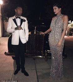 The look of love: Kylie, 18, posed with 25-year-old boyfriend Tyga in front of a Rolls Royce. He wore a tuxedo and carried a cigar