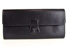 LOUIS VUITTON Black Epi Leather Jewelry Case Clutch. Get the trendiest Clutch of the season! The LOUIS VUITTON Black Epi Leather Jewelry Case Clutch is a top 10 member favorite on Tradesy. Save on yours before they are sold out!