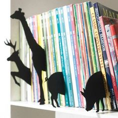 Neat idea for an easy way to decorate a bookshelf and maybe tell people something about what's on the shelf.