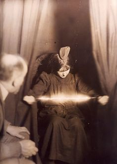 """Albert von Shrenck Notzing:  """"The medium Eva.C with a materialisation on her head and a luminous apparition between her hands"""", 17 May 1912"""